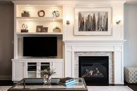 Living Room With Fireplace In The Middle by Before And After Living Room And Dining Room Makeover Shelving