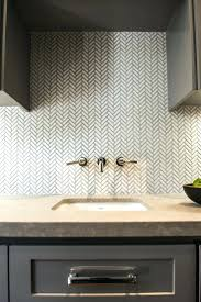 white herringbone tile backsplash kitchen sink tiles white