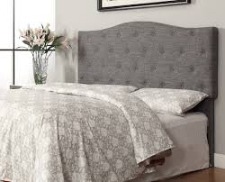bedroom cozy tufted bed with gray wingback headboard and white