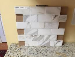 wondering if this calcutta gold marble backsplash will work with my gr