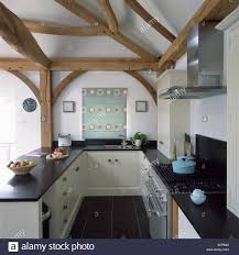 100 Modern Barn Conversion Wooden Beams And Green Patterned Blind On Window In Modern Barn