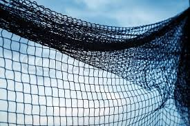 Fishing net silhouette above blue sky background