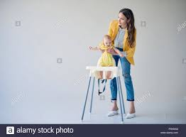 Beautiful Stylish Mother Putting Baby Girl In High Chair On ... Safety First Timba Highchair White High Chairs Strolleria Ikea Chair With Standing Laptop Station Fniture Little Girl Standing Image Photo Free Trial Bigstock Handsome Artist Eyeglasses Gallery Amazoncom Floorstanding High Bracket Bar Lift Modern Girl Naked On A Chair Stand In The Bathroom Tower Or Learning Made Splendid Office Desks Amusing Solar Cantilever Leander Free Worth Vitra Rookie