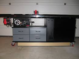 Sawstop Cabinet Saw Outfeed Table by My Sawstop And Router Cabinet With Fold Down Outfeed Table And
