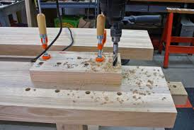 how do you make plumb vertical holes i e dog holes in a 4