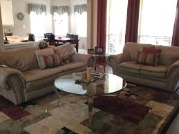 Decorating With Brown Couches by Help Matching Taupe Leather Couches Hardwood Floors Curtains