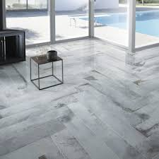 decor roma tile flooring with white base board also beige paint