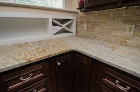 kashmir gold granite kitchen traditional with cement floor