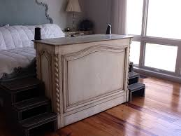 Traditional end of bed furniture with hidden TV inside traditional bedroom