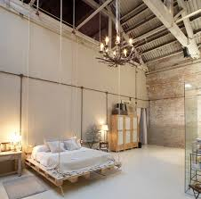 Barn Style With Chandelier Exposed Brick Bedroom