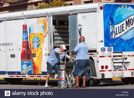Two Delivery Men Unload Beer From A Blue Moon Brewing Company ... South Hills Movers Erica Shulsky Luxury Expert Two Delivery Men Unload Beer From A Blue Moon Brewing Company Two Men And A Truck 6 Things To Consider When Choosing Removalist Men And Truck Explepahistorycom Image Sponsors Great Lakes Loons About And Boynton Beach Delray Florida Facebook Police Steal Walmart Two Times In One Week News Of Athens Ga Home Killed Massive Pileup On I80 During Blding Snowstorm Pepsi Cola Delivery Stock Photos