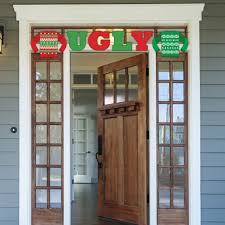 Mardi Gras Wooden Door Decorations by Ugly Christmas Sweater Party Ideas