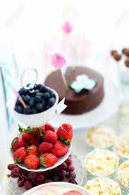 berry canapes berries popcorn canapes candies and a chocolate cake on a stock