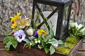 Black Rustic Lantern Centerpiece Combined With Spring Flower Decoration Along Brown Wooden