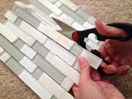 diy kitchen backsplash part 4 installing backsplash tiles