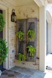 Love These Old Shutters As Plant Holders On The Porch Repurposed ShuttersOld DecorShutter Wall