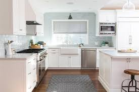 white shaker kitchen cabinets with blue glazed subway tile
