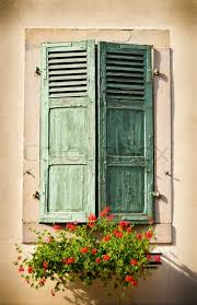 Isolated View Of A Window With Green Shutters Flower Box