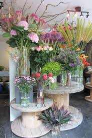 Cable Spools As Display For Flower Shop Booth Could Use Other Things Well