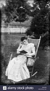 1890s WOMAN SITTING IN ROCKING CHAIR IN BACKYARD READING ... Rocking Chair Black And White Stock Photos Images Alamy Sold Pink Cottage Beachview Fding The Value Of A Murphy Thriftyfun Amish Ash Wood Porch From Crystal Cove Vintage Meridonial Lounge Chair By Auguste Thonet 1890s Originals Chairmakers Goldwood Boris Antique Armchair Hap Moore Antiques Auctions The Chairis In House Restoring Ross