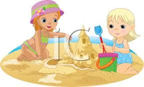 Toddlers Building A Sandcastle At The Beach
