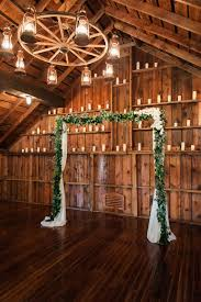 Simple Eucalyptus Garland Wedding Arch For A Barn And Candles Around An Ambience