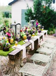 Rustic Wooden Table And White Lazy Chairs For Summer Backyard Party Decoration With Elegant Flowers
