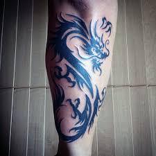 Forearm Tribal Dragons Tattoos On Guys