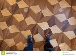 Download Person Standing With Sports Shoes On Parquet Floor Top View Stock Photo