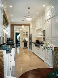 galley kitchen with hanging lights and pendant lighting fixtures