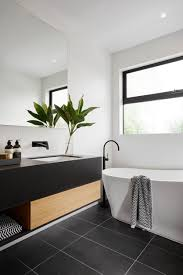 modern black and white bathroom with black tile matte black