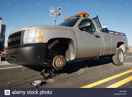 A Pickup Truck With A Missing Front Wheel Jacked Up Stock Photo ... Pick Up Trucks Jackedup Or Tackedup Whisnews21 White Chevy Jacked Good Diesel For Sale With Does Lifting Truck Affect Towing The Hull Truth Boating And Lifted Classic Gmc Chev Fanatics Twitter Gmcguys Up Pictures Images Pin By Camille Dalling On Square Body Nation Pinterest 4x4 That Moment You Realize Its A 2 Wheel Drive Ive Been Seeing In Salem Hart Motors Best Worst Lifted Trucks We Saw At Sema Video Roadshow Toyota Tundra Altitude Package Rocky Ridge