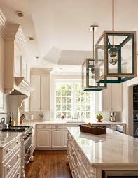 stunning white kitchen with tray ceiling oversized pendant lights