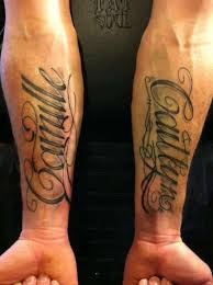 A Truly Inspiring Double Hand Name Tattoo For The Forearms In This Image We See Caitlyn And Camille Tattooed Beautiful Cursive Font On