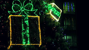 Blinking Christmas Tree Lights by Reflection Of Flashing Red Lights At The Window In A Dark Room At