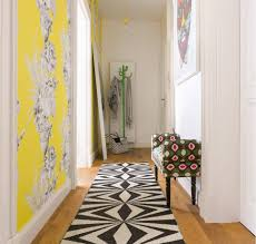Yellow Accent Wall For The Small Apartments Hallway