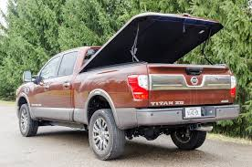 100 Nissan Frontier Truck Cap ARE Tonneau And DCU Installed On 2017 Titan XD Cummins