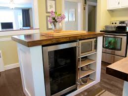 small kitchen island design ideas come with white base and brown