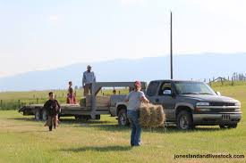 The Art Of Picking Up Hay Bales | Jones Land & Livestock, Inc.