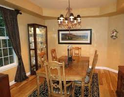 Tuscan Style Dining Room With Wall Art And Display Cabinet