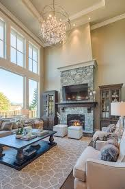 living room with two story windows gorgeous lighting large area rug stone