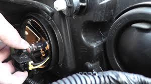 ford escape headlight bulbs install