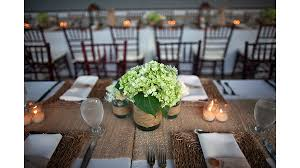 Rustic Burlap Wedding Decorations With Green Flowers In Small Glass Jar And Candles On Long