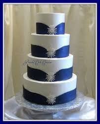 White And Blue Wedding Cake With Silver Jewelry