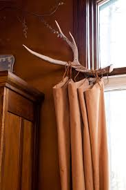 since we live in the mountains i thought a deer horn curtain rod