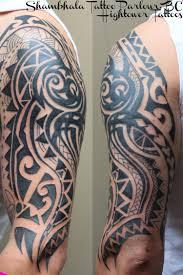 Black Ink Tribal Tattoo On Left Half Sleeve