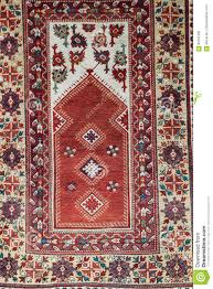 Download Hanging Carpet From Islamic Art With Red Color Stock Photo