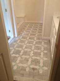bath floor was a plastic faced marble mosaic tile with a marble