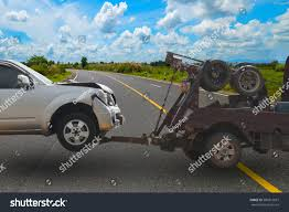 Tow Truck Delivers Damaged Vehicle Stock Photo & Image (Royalty-Free ... Tow Truck Driver Cheats Death Dodges Skidding Car In Crazy Crash A Smashed Up Charter Bus Being Towed By A After Highway Blured Police Department Accident Stock Photo Royalty How To Get Paid Rates When Aaa Is Involved Company Towtruck Killed School Youtube Towing 131tow T Bone With Painful Extrication 62nd Pacific Milwaukee Service 4143762107 Hauling Away Passenger After Traffic Between Bike And Tow Truck Towing Accident Rollover Crash Remorquage Lapd Nicb Warn Of Bandit Scams