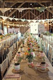 Lovely Indoor Wedding Reception Set Up Love The Bunting And Wildflowers On Table